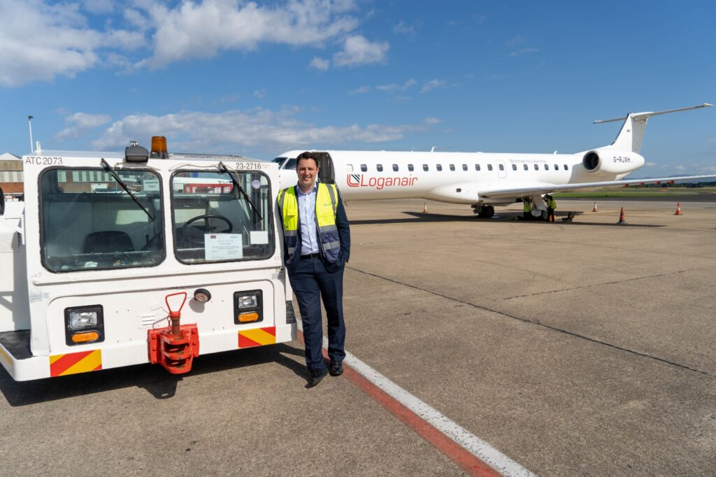 Mayor Houchen at Teesside Airport with an aircraft support Tug